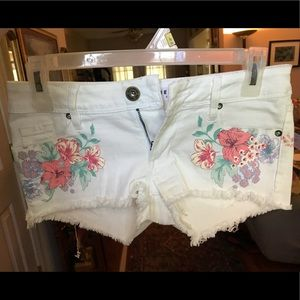 White jean shorts with tropical flowers
